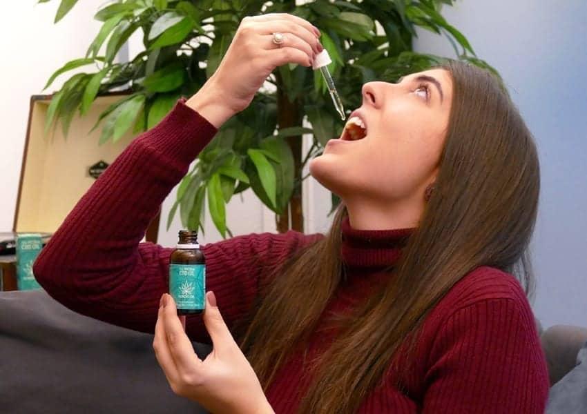 Woman taking CBD Oil