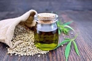 Oil in a bottle on seeds