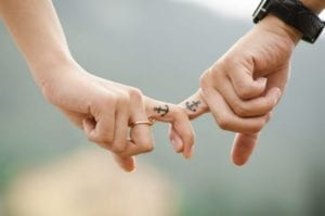 Couple fingers crossing